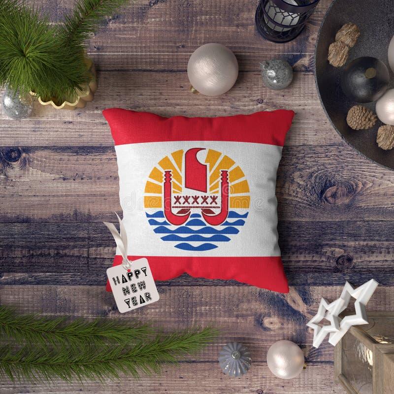 С Новым Годом! бирка с флагом Французской Полинезии на подушке r стоковая фотография rf