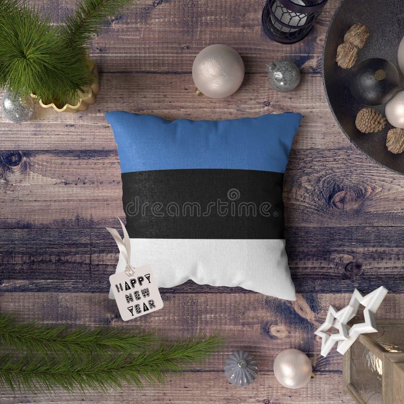 С Новым Годом! бирка с флагом Эстонии на подушке r стоковые изображения rf