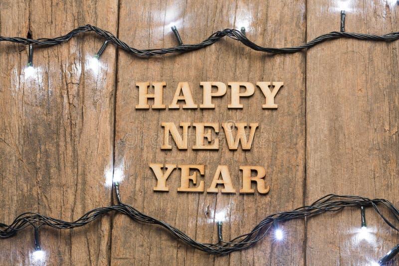 С Новым Годом! - деревянная предпосылка стоковое фото