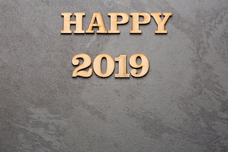 С Новым Годом! 2019 - письма на древесине и черной предпосылке стоковая фотография