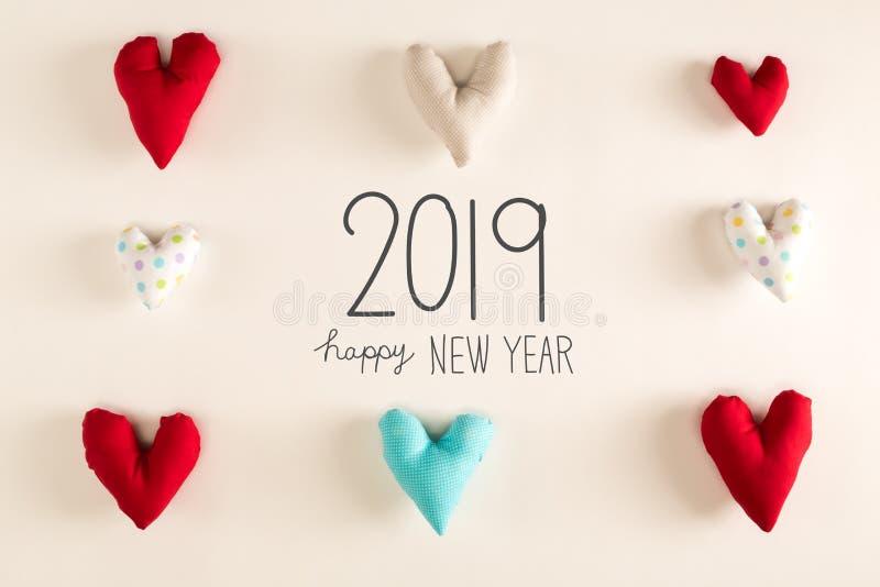 С Новым Годом! сообщение 2019 с голубыми валиками сердца стоковое фото
