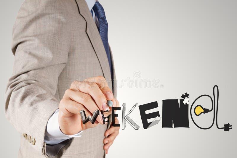Слово ВЫХОДНЫЕ дизайна чертежа руки бизнесмена графическое стоковые изображения