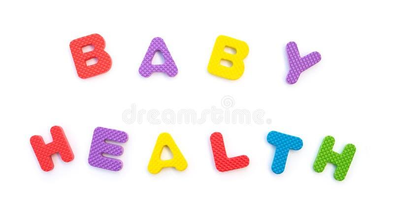 Слово здоровья младенца сформировало головоломками алфавита стоковые фотографии rf