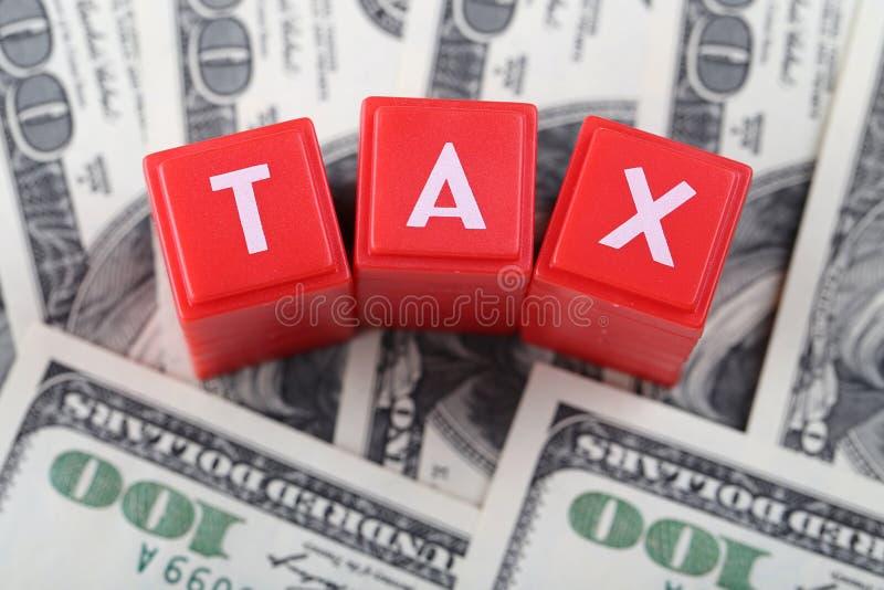 Слово налога с деньгами стоковые фотографии rf