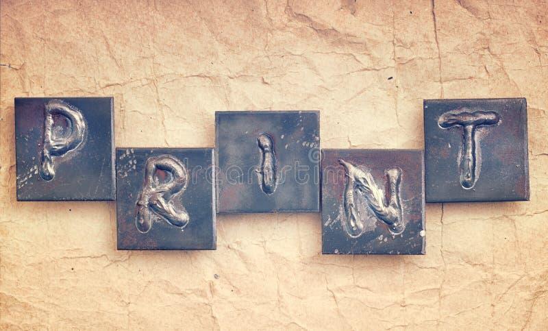 Слово ПЕЧАТЬ сделанная от писем металла стоковые изображения rf