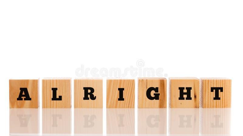 Слово - Alright - на деревянных блоках стоковые фото