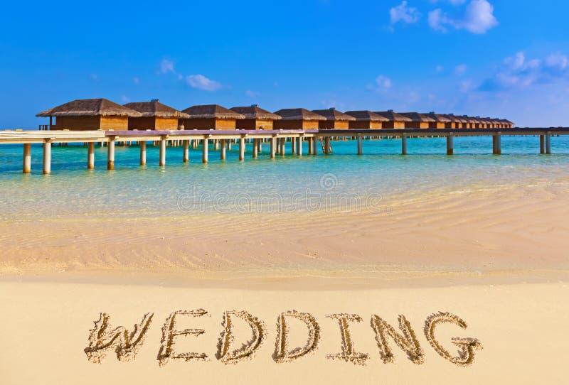 Слово Weddind на пляже стоковые изображения rf