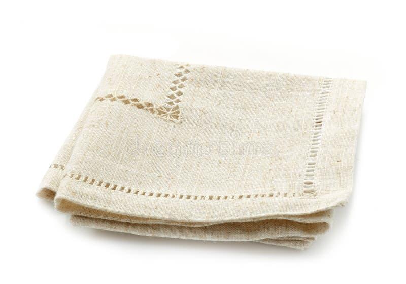 Сложенная linen салфетка стоковые фото