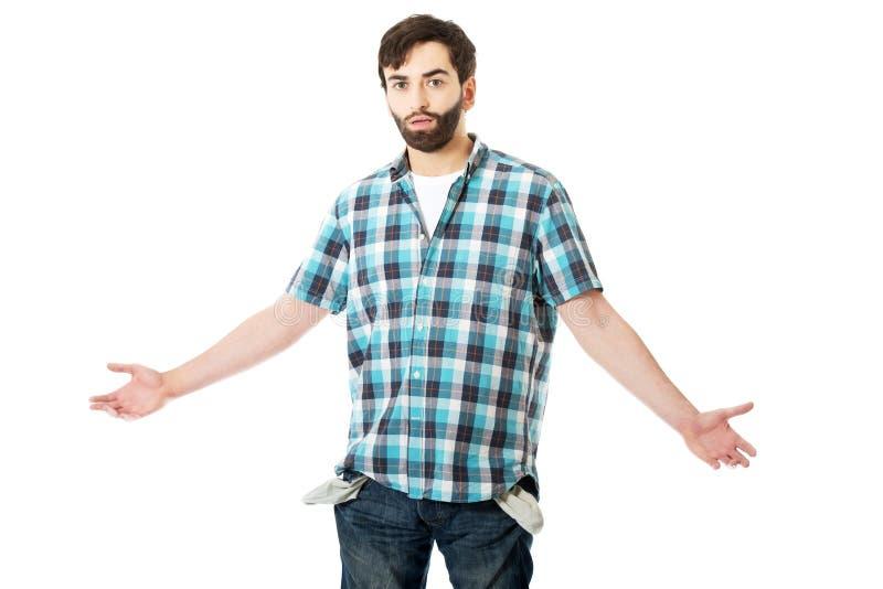 Сломал молодого человека с пустыми карманн стоковое изображение rf