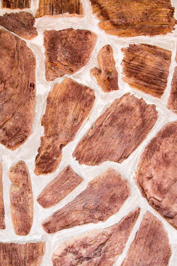 Случайная коричневая каменная стена стоковое изображение rf