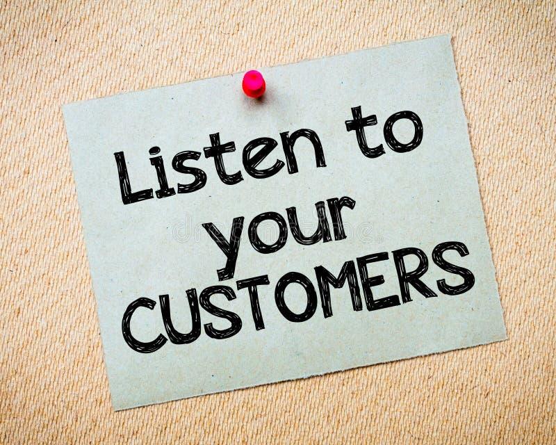 Слушайте к вашим клиентам стоковое фото
