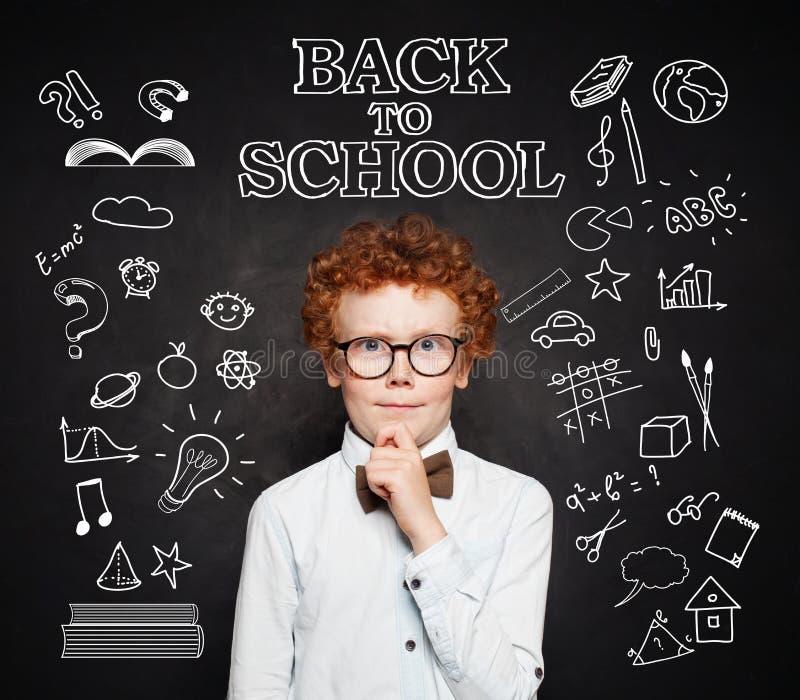 Ð¡hild pupil thinking on Back to school background stock image