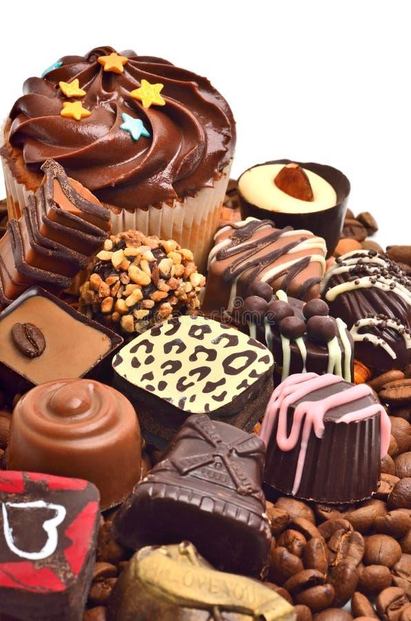 Сhocolate cukierki, muffins i kaw adra, obraz stock