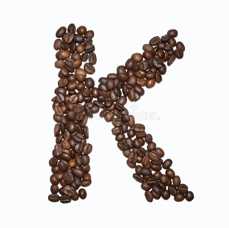 Сoffee letter - K. English Coffee Alphabet isolated on white. Roasted coffee beans. Ð¡offee letter - K, text, drink, food, sign, brown, cafe, background royalty free stock images