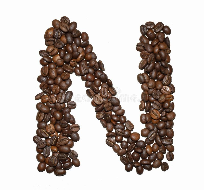 Сoffee letter - N. English Coffee Alphabet isolated on white. Roasted coffee beans. Ð¡offee letter - N, text, drink, food, sign, brown, cafe, background royalty free stock photos