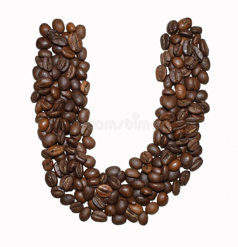 Сoffee letter - U. English Coffee Alphabet isolated on white. Roasted coffee beans. Ð¡offee letter - U, text, drink, food, sign, brown, cafe, background royalty free stock images