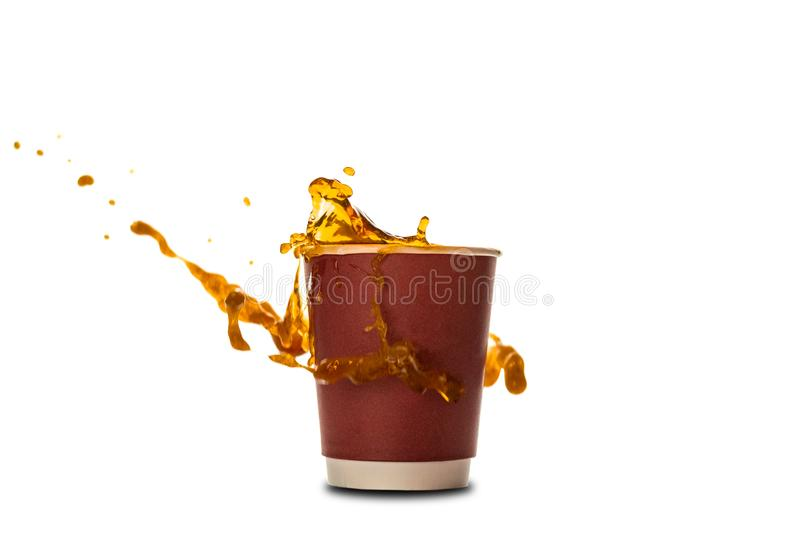 Ð¡offee splash in paper coffee cup isolated on white background. Concept: coffee advertising stock images