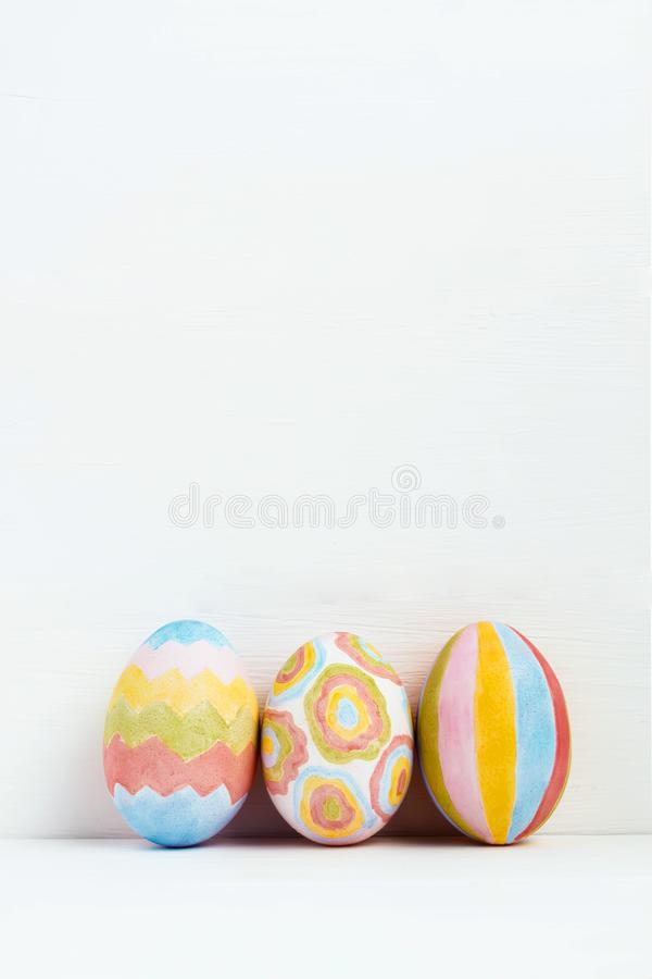 Ð¡olorful Easter eggs decorated with geometric patterns on white background stock photos