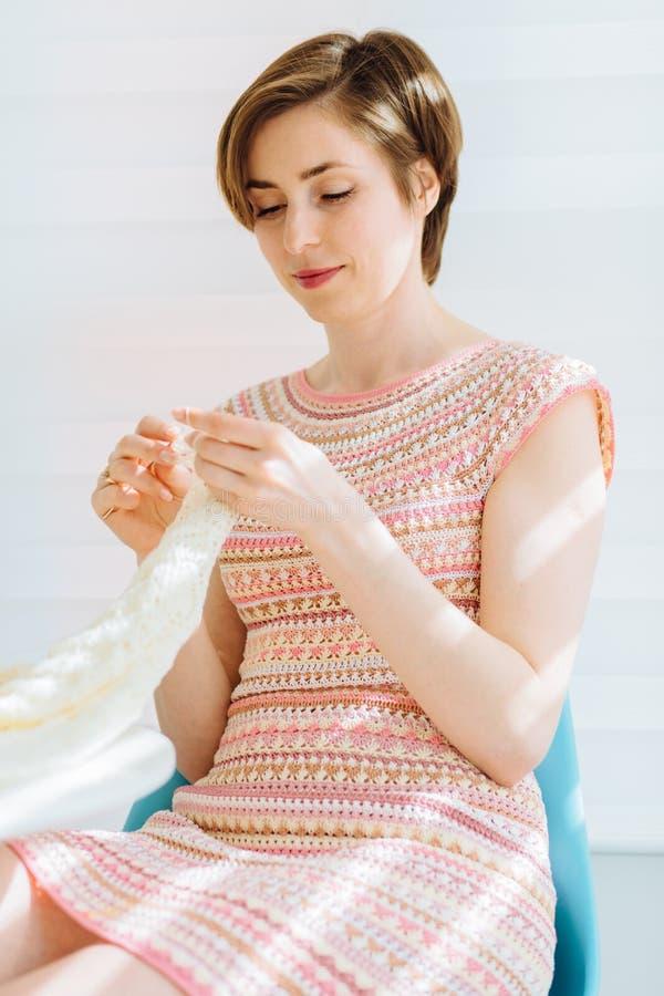 Ð¡raftswoman crochet handmade indoor. Vertical close up portrait. Business crochet homemade relaxation concept stock photos
