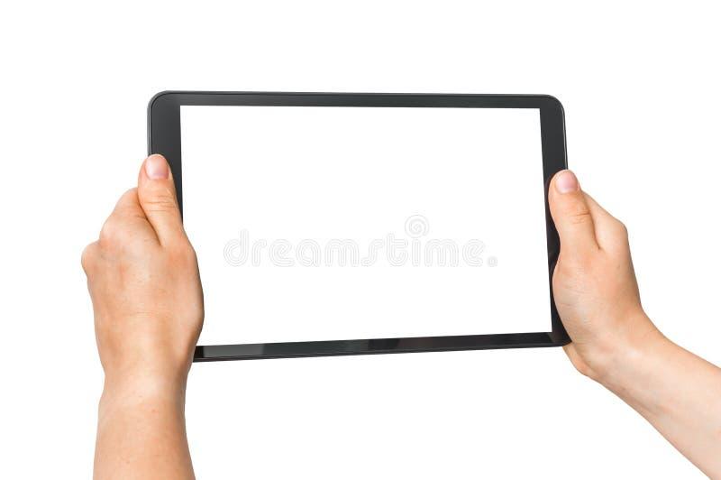 Таблетка с пустым белым экраном в женских руках стоковая фотография
