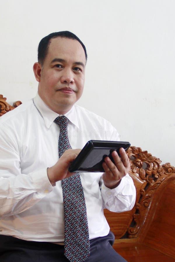 таблетка человека компьютера дела стоковое фото rf