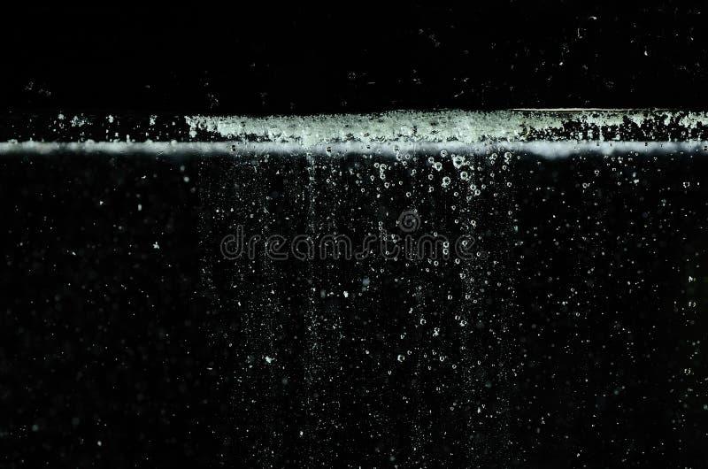 Таблетка аспирина в воде стоковые фотографии rf