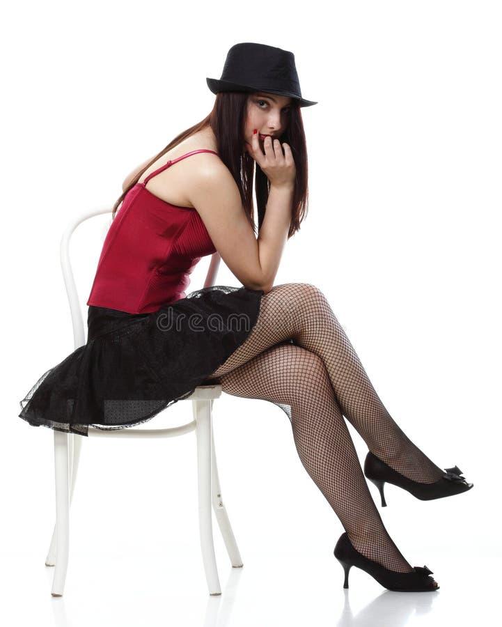 Download Таец женщины танцовщицы в красной изолированной белизне стула корсета Стоковое Изображение - изображение насчитывающей счастливо, повелительница: 33734695