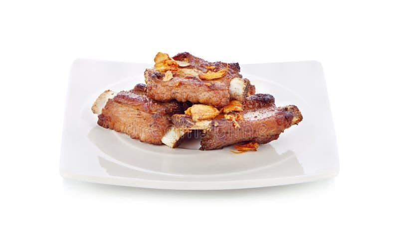 Тайская еда стиля, свинина зажарила с хрустящим чесноком стоковые фото
