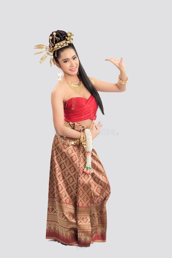 Тайская женщина в традиционном костюме Таиланда стоковая фотография