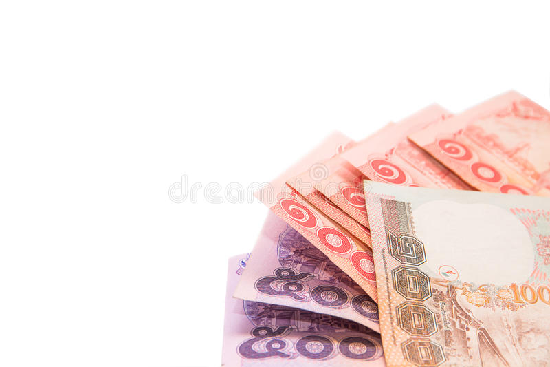 Тайские банкноты и монетка для сохранять на белой предпосылке стоковая фотография