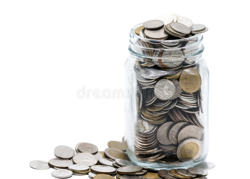 Тайские монетки в стеклянном опарнике стоковое фото