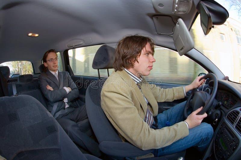 таксомотор пассажира водителя стоковое изображение