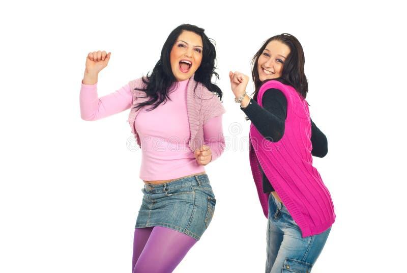 танцующ 2 женщины молодой стоковые изображения rf