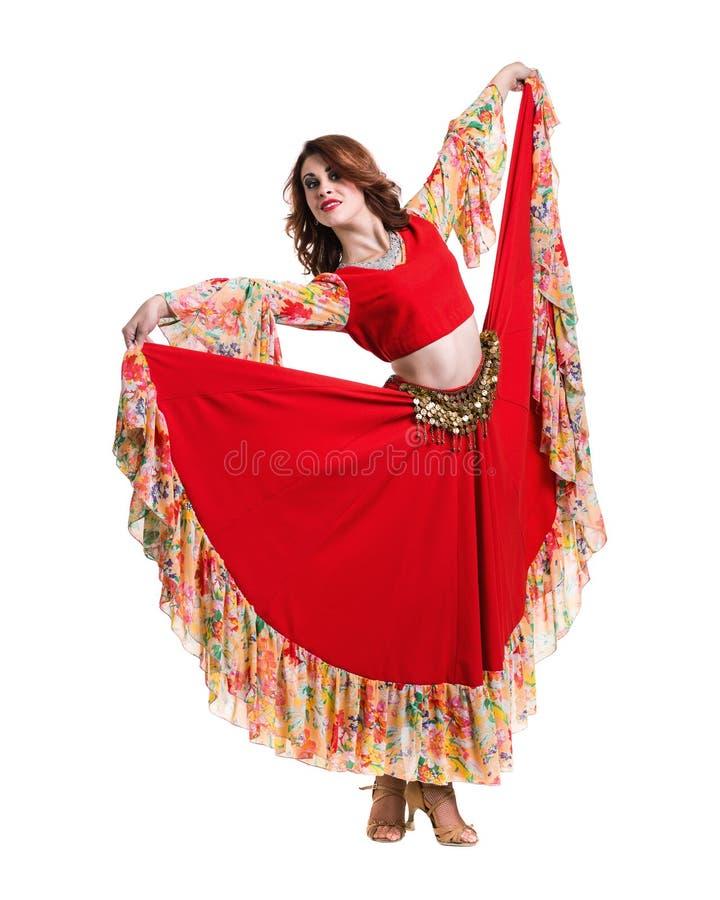 Танцы молодой женщины, изолированное полностью тело на белизне стоковая фотография