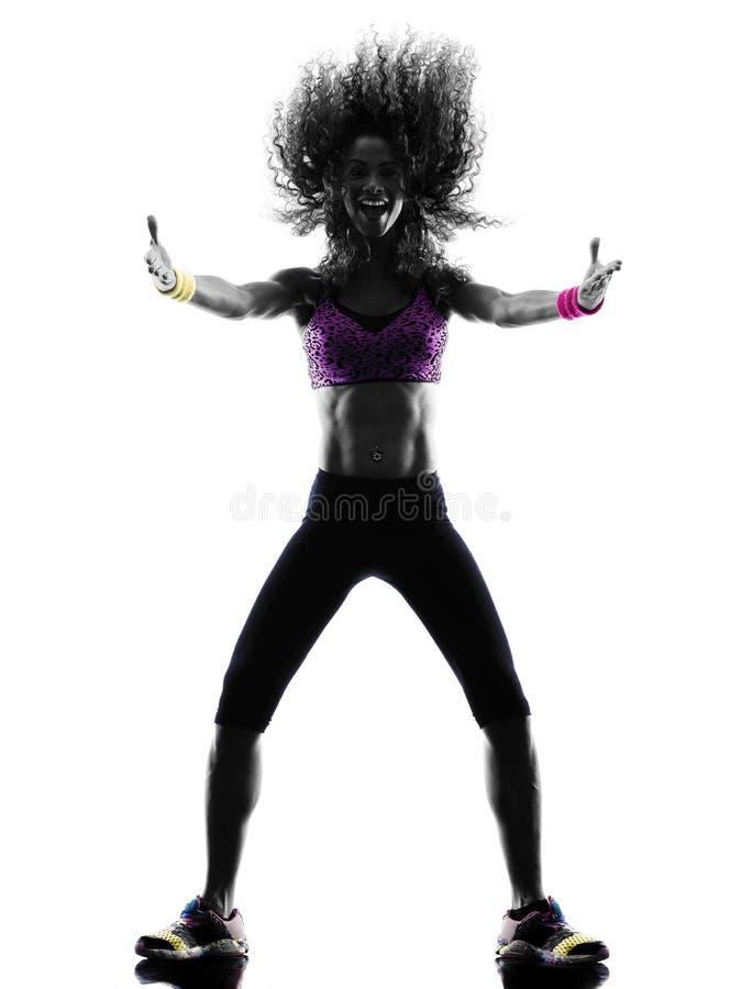 Танцы танцора zumba женщины работают силуэт стоковое изображение rf
