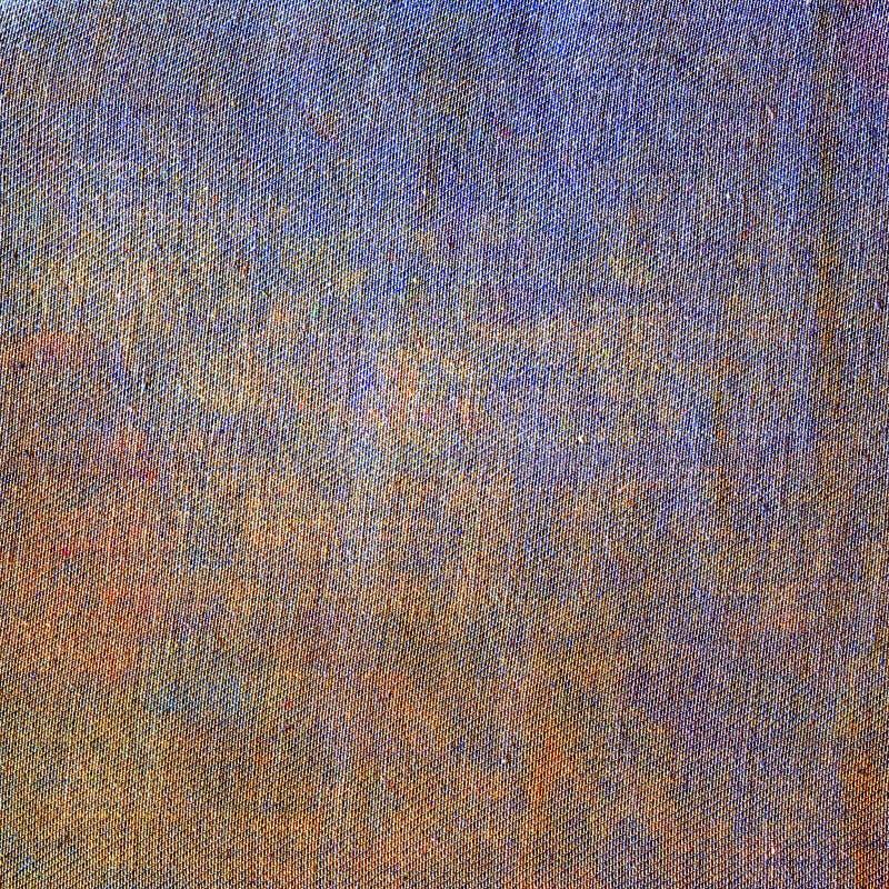 Творческая предпосылка текстуры джинсов Голубой желтый оранжевый холст цвета стоковое фото rf