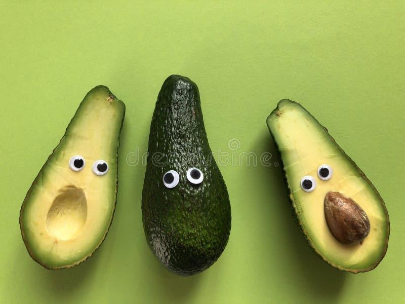 Творческая смешная концепция еды, авокадоы стоковое фото rf