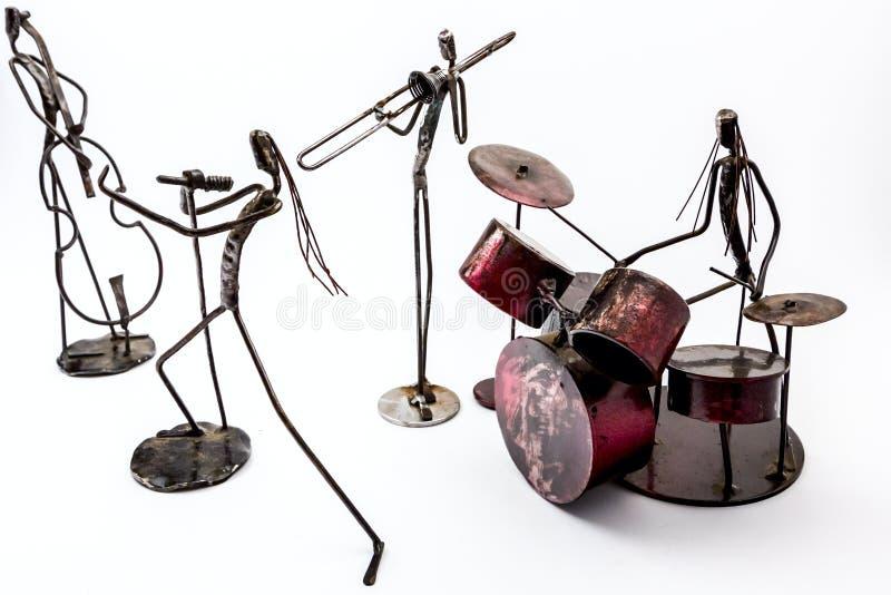 Творческие диаграммы музыкантов, певицы с violoncellist, dru стоковое фото