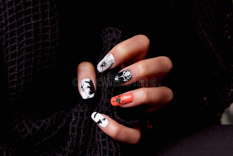 Творческие ногти на хеллоуин стоковое фото