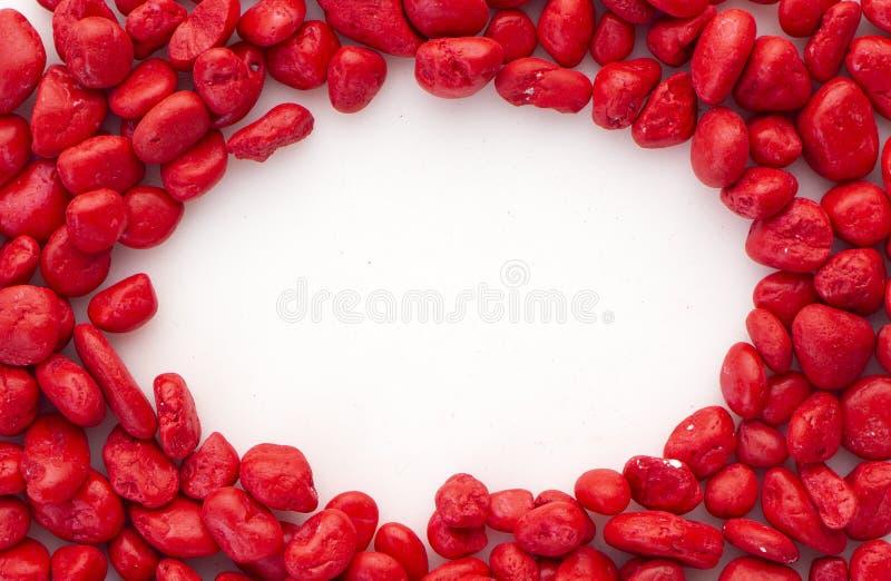 Творческий красный камень на белизне стоковые фото