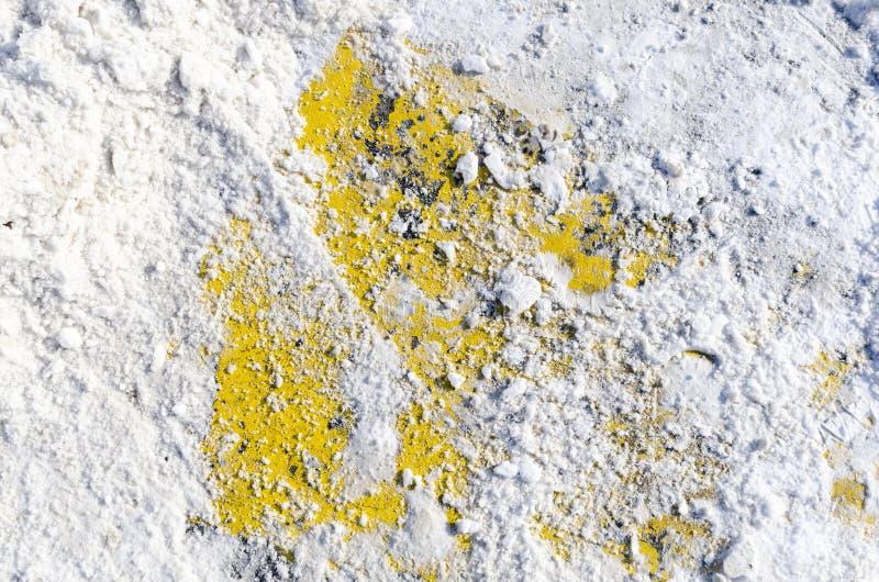 Текстура асфальта в снеге стоковое фото