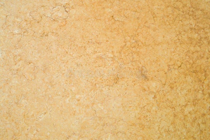 Текстура бежева, коричневый цвет, заволакивание стены ровная, несродная структура, гипсолит, покрытый с краской декоративная конс стоковые фото