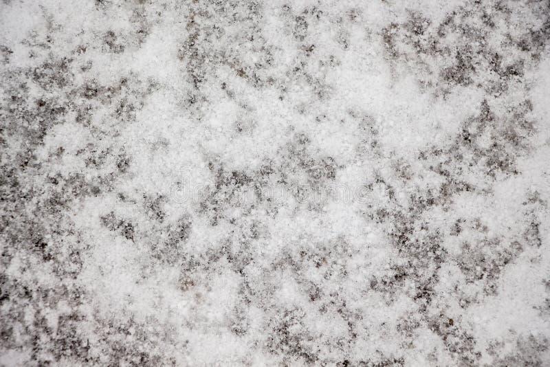 Текстура белого снега на асфальте Предпосылка снега для design_ стоковые изображения rf