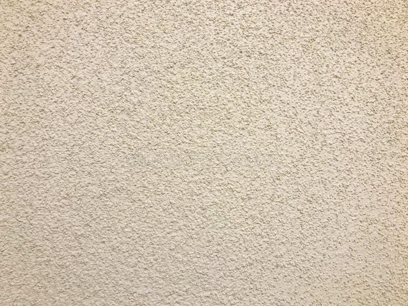 Текстура грубой стены бежевого декоративного гипсолита используемого для отделки стен входов зелень gentile предпосылки абстракци стоковые изображения