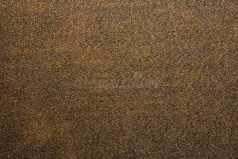 Текстура джинсовой ткани коричневая стоковое изображение