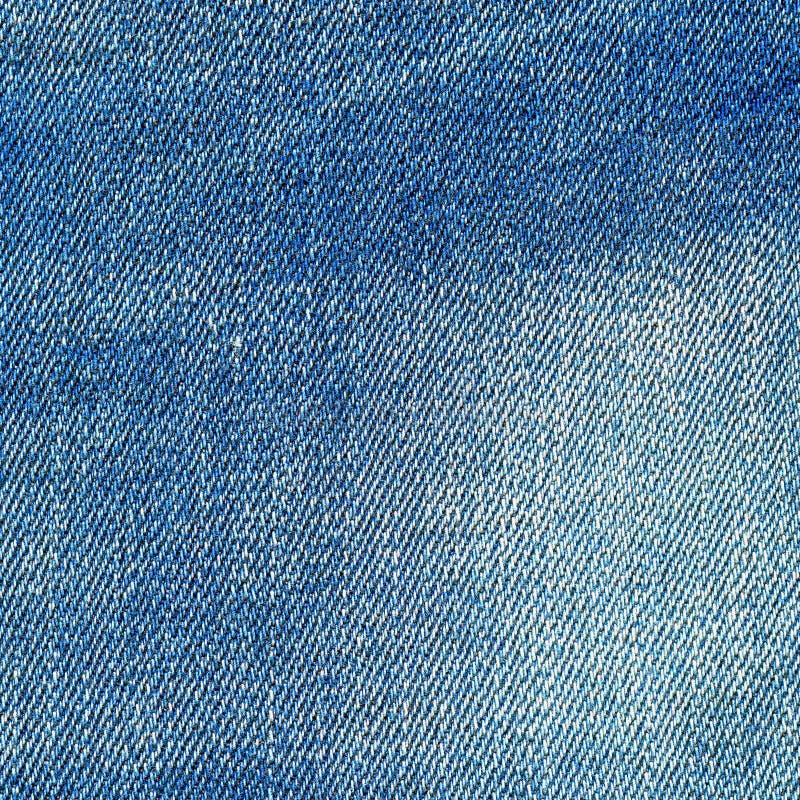 Текстура джинсовой ткани, свет - предпосылка голубых джинсов стоковое изображение rf