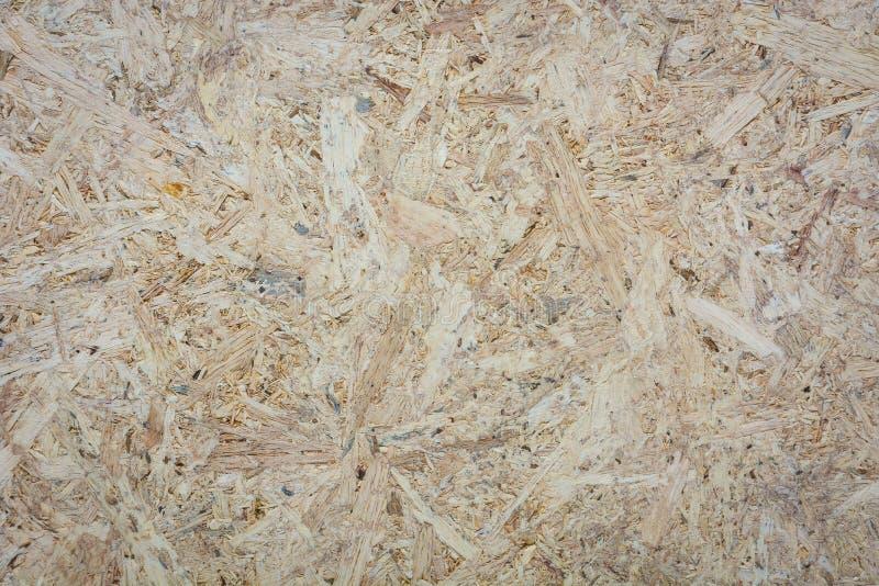 Текстура доски переклейки OSB, отжала деревянную предпосылку панели стоковая фотография