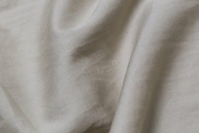 Текстура естественной ткани linen для дизайна Cream холст для предпосылки Изображение имеет малую глубину поля стоковое изображение rf