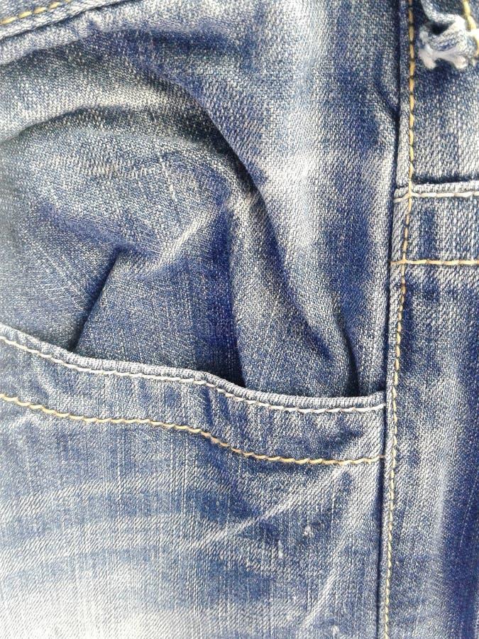 Текстура и джинсы джинсовой ткани нашивки стоковая фотография rf