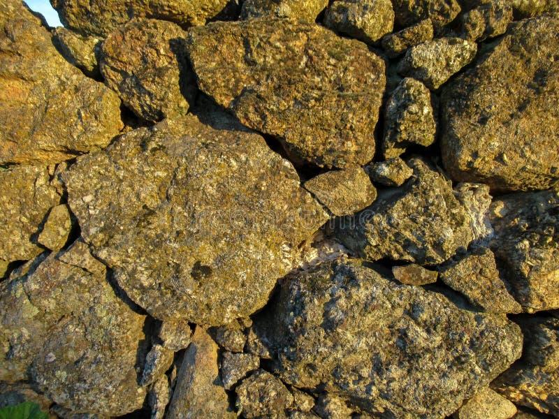 Текстура и картина: Каменная стена стоковое фото